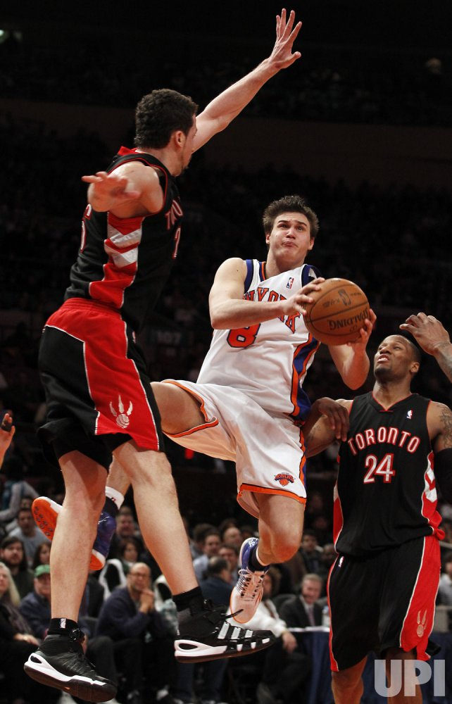 New York Knicks Danilo Gallinari drives by Toronto Raptors Sonny Weems at Madison Square Garden in New York