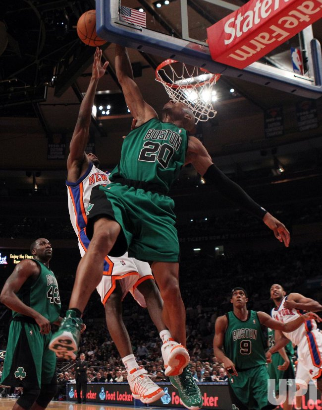 Boston Celtics Ray Allen blocks a shot from New York Knicks Toney Douglas at Madison Square Garden