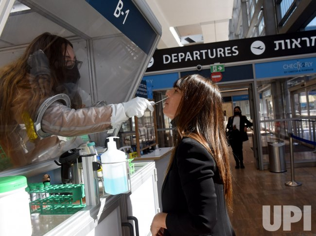 A Woman Takes A Rapid COVID-19 Test In Ben Gurion Airport