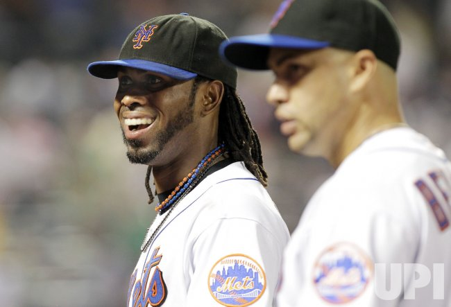 New York Mets Jose Reyes and Carlos Beltran walk to the dug out at Citi Field in New York