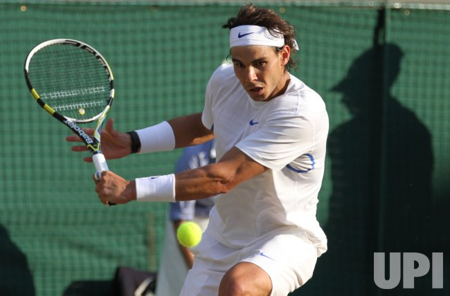 Rafael Nadal returns at Wimbledon.