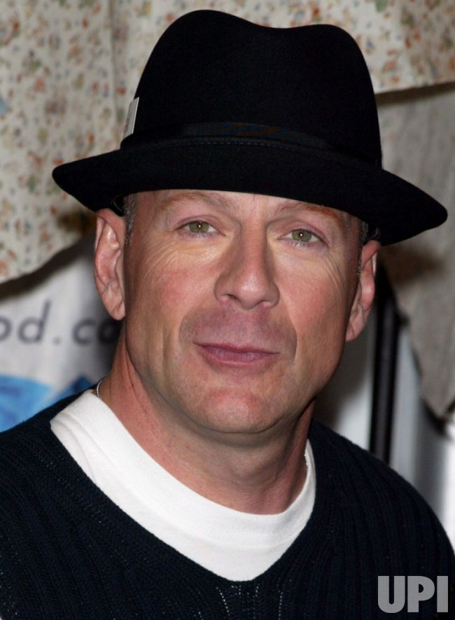 BRUCE WILLIS AT PLANET HOLLYWOOD IN NEW YORK