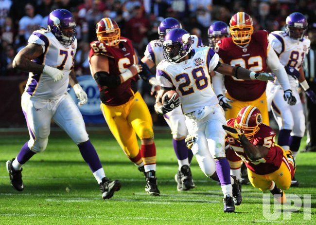 Minnesota Vikings Adrian Peterson carries the ball in Washington