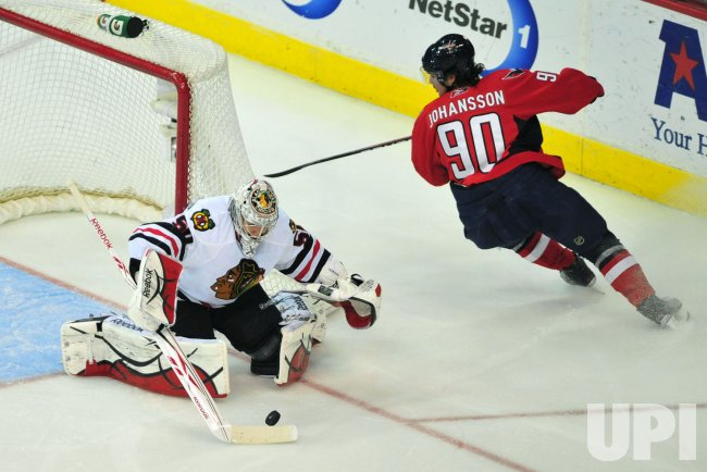 Chicago Blackhawks' goalie Corey Crawford stops a shot by Washington Capitals' Marcus Johansson in Washington