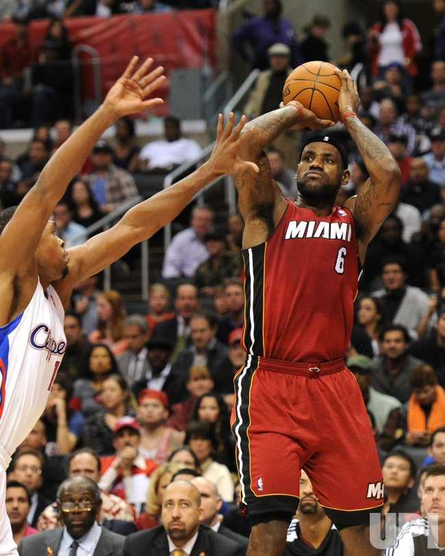 LeBron James scores over Los Angeles Clippers