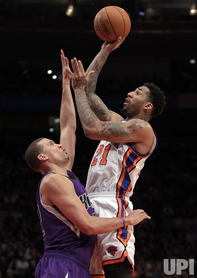 New York Knick Wilson Chandler shoots over Sacramento Kings Francisco Garcia at Madison Square Garden in New York