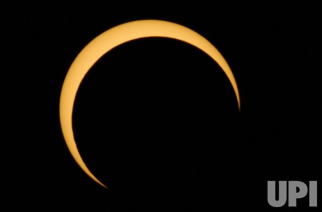 Annular eclipse occurs throughout the western USA.