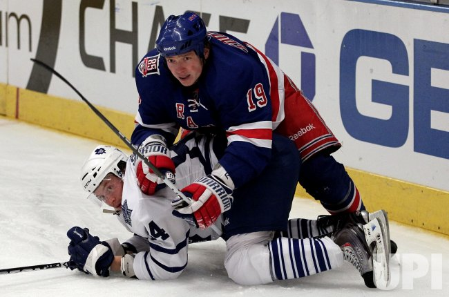 New York Rangers Ruslan Fedotenko pins Toronto Maple Leafs Mikhail Grabovski to the iceat Madison Square Garden in New York