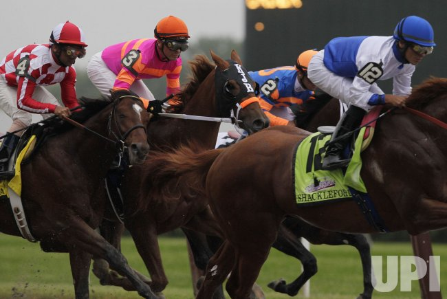 """Jockey Jose Valdivia Jr. and Horse """"Ruler On Ice"""" win the 143rd Belmont Stakes in New York City"""