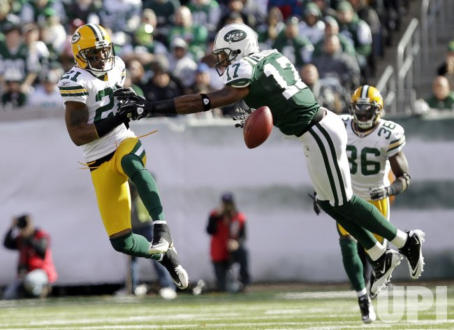 Green Bay Packers Charles Woodson breaks up a pass intended for New York Jets Braylon Edwards at New Meadowlands Stadium in New Jersey