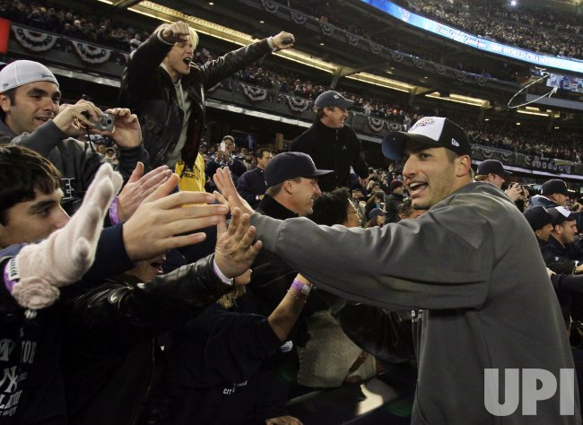 New York Yankees Andy Pettitte reacts with fans after the game against the Philadelphia Phillies in game 6 of the World Series at Yankee Stadium in New York