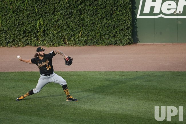 Pirates pitcher Trevor Williams warms up at Wrigley Field in Chicago