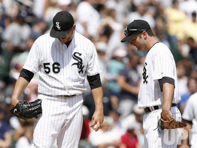 Chicago White Sox first baseman Paul Konerko talks with starting pitcher Mark Buehrle against the New York Yankees
