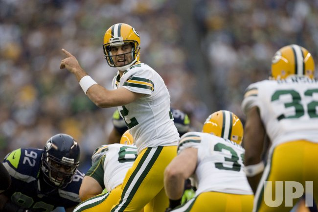Green Bay Packers quarterback Aaron Rodgers changes a play against Seattle Seahawks at CenturyLink Field in Seattle.