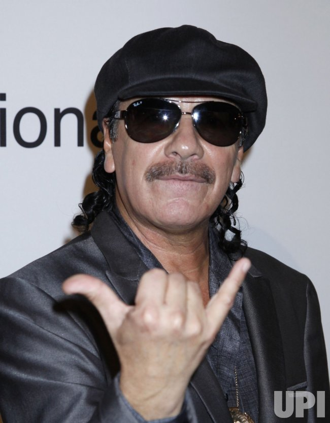 Carlos Santana arrives at the Clive Davis Pre-Grammy Gala in Beverly Hills