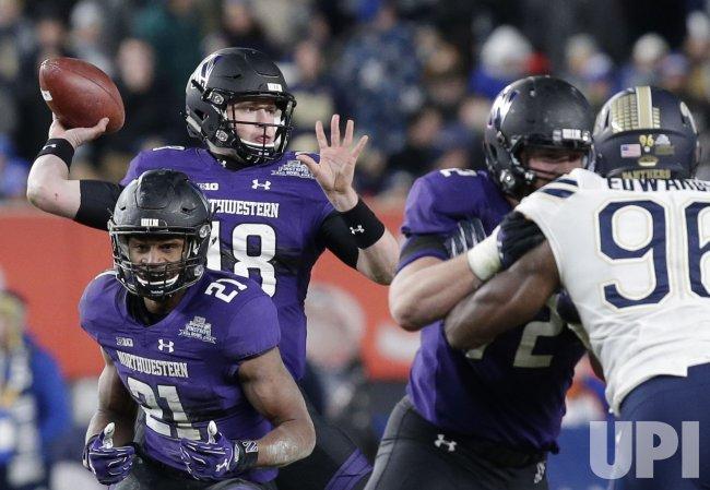 Northwestern Wildcats Clayton Thorson throws a pass