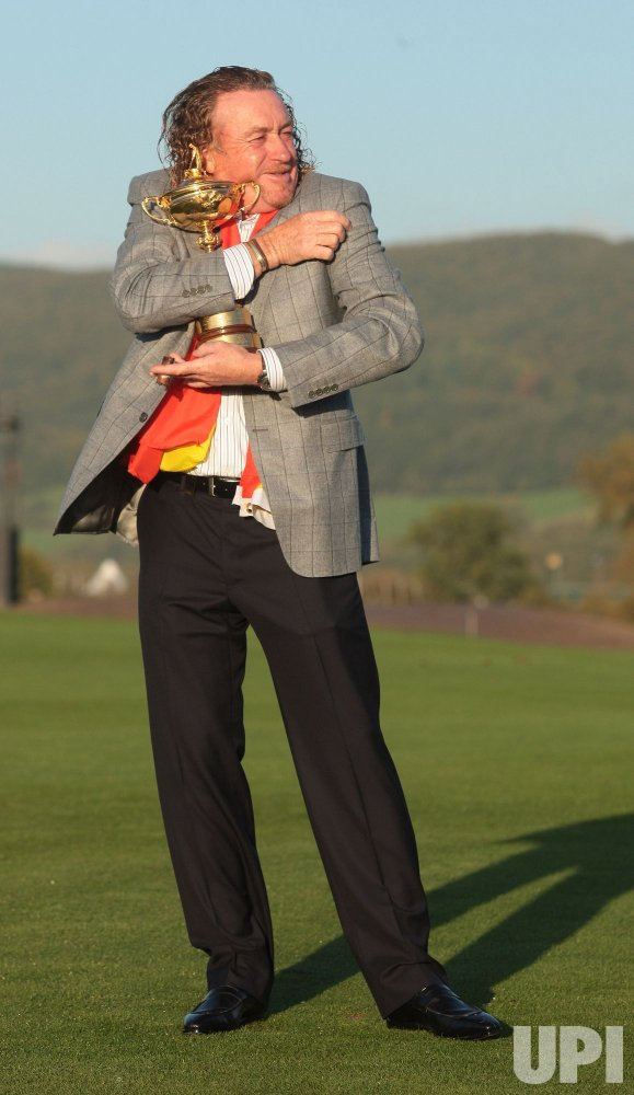 Angel Jimenez cuddles the Ryder Cup
