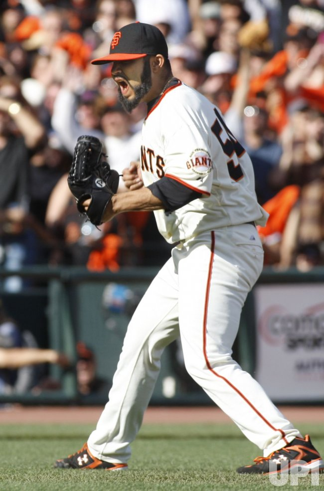 Giants Sergio Romo yells after striking out San Diego Padres Yorvit Torrealba in San Francisco