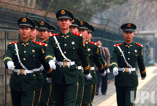 Soldiers march past North Korean embassy in Beijing