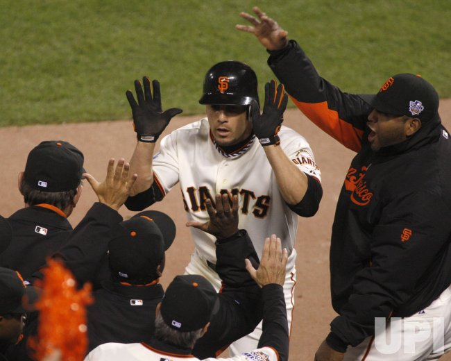 Giants Andres Torres scores against the Texas Rangers in the World Series in San Francisco