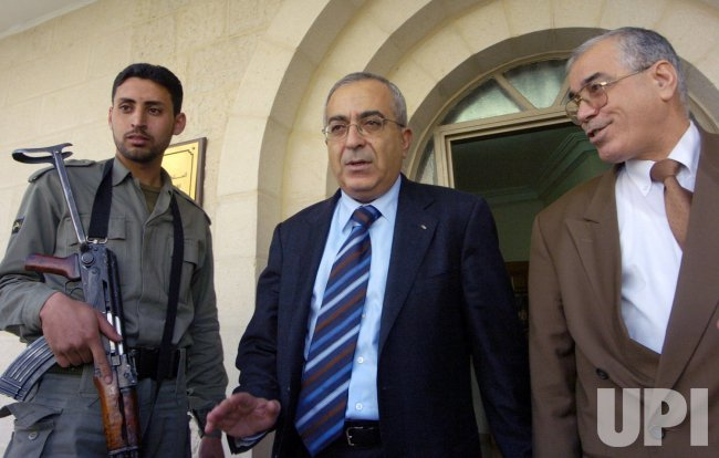 SALAM FAYYAD, FINANCE MINISTER AND NASSER YOUSEF, INTERIOR MINISTER LEAVE PRIME MINISTER AHMED QUREIA'S OFFICE