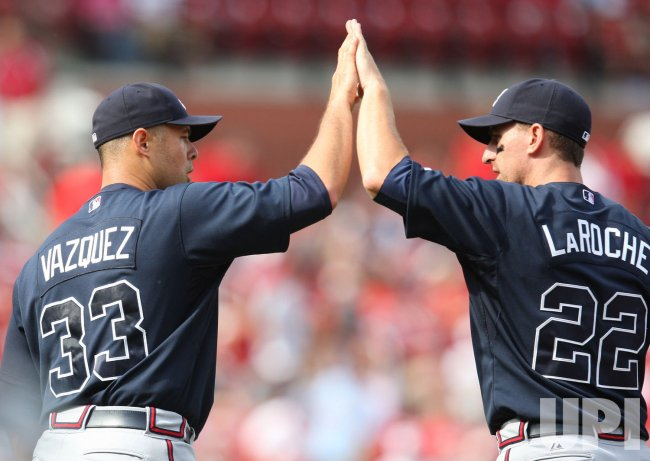 Atlanta Braves Javier Vazquez and Adam LaRoche celebrate in St. Louis