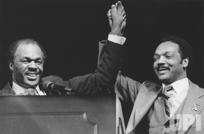 DC Mayor Marion Barry raises hands with presidential candidate Jesse Jackson