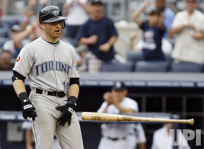 Toronto Blue Jays Marco Scutaro strikes out against the New York Yankees at Yankee Stadium in New York