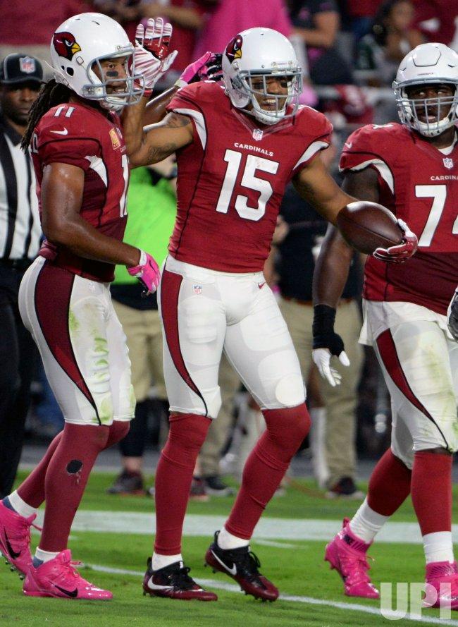 Cardinals' Floyd celebrates touchdown