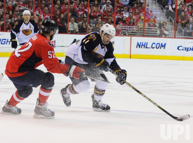 Capitals Green defends against Thrashers MacArthur in Washington