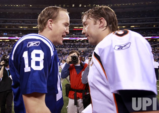 Colts Manning Greets Broncos' Orton