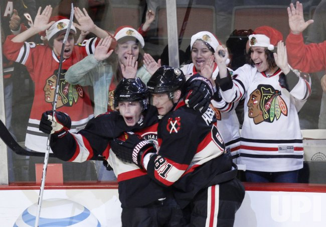 Blackhawks' Kane and Hossa celebrate goal against Sharks in Chicago