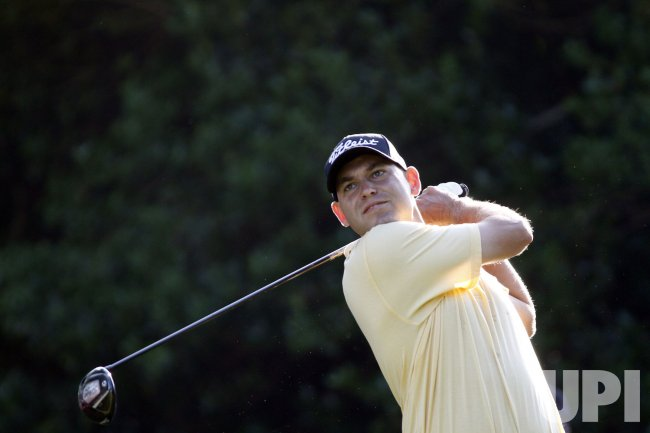 Bill Hass hits tee shot in the Wells Fargo Championship
