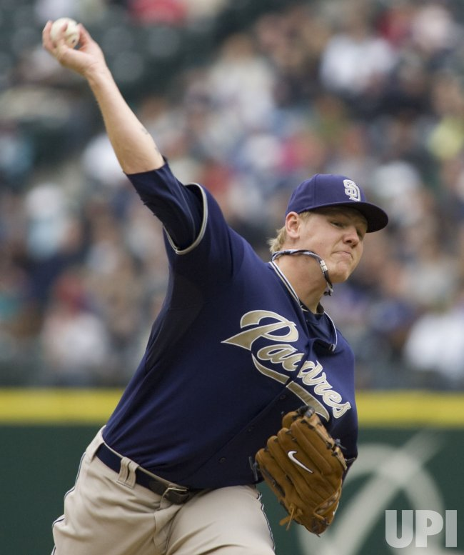 Padres' Mat Latos pitches against the Seattle Mariners in Seattle
