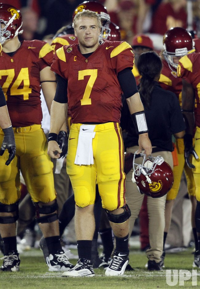 USC quarterback Matt Barkley (7) watches in a timeout in OT against Stanford at the Coliseum in Los Angeles
