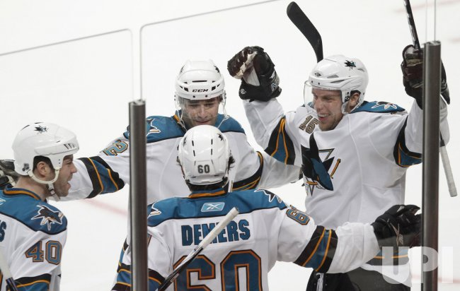 Sharks celebrate Demers' goal againsth Blackhawks in Chicago