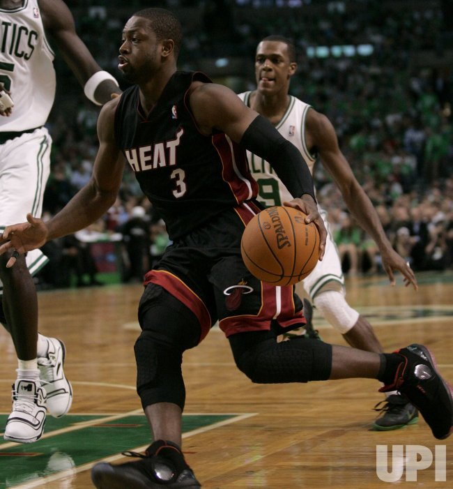 Miami Heat's Dwyane Wade drives to net against Celtics in Boston, MA.