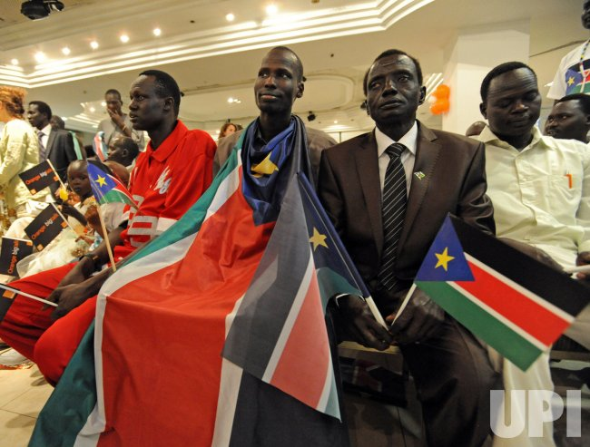 A Southern Sudanese refugee wears the South Sudan flag during independence celebrations in Tel Aviv, Israel