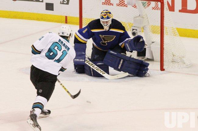 San Jose Sharks Justin Braun takes a shot against St. Louis Blues goaltender Brian Elliott