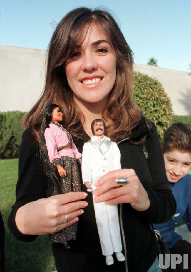 Donna Berry of Victorville, Ca. poses with a Sonny and Cher doll set