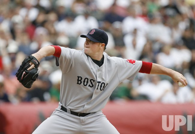 Boston Red Sox starting pitcher Jon Lester delivers a pitch against the Chicago White Sox