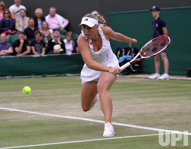 Caroline Wosniacki returns at Wimbledon.