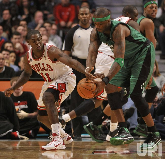 Bulls Brewer steals ball from Celtics O'Neal in Chicago