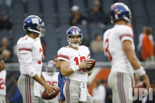 New York Giants quarterback Eli Manning warms up before a preseason football game in Chicago