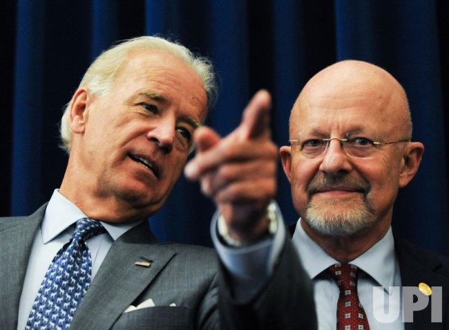 Vice President Biden swears-in Intelligence Director James Clapper in Washington