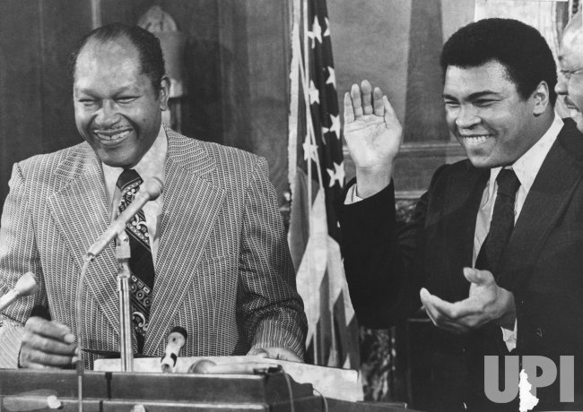 Muhammad Ali cracks jokes with Mayor Tom Bradley at a press conference in Los Angeles