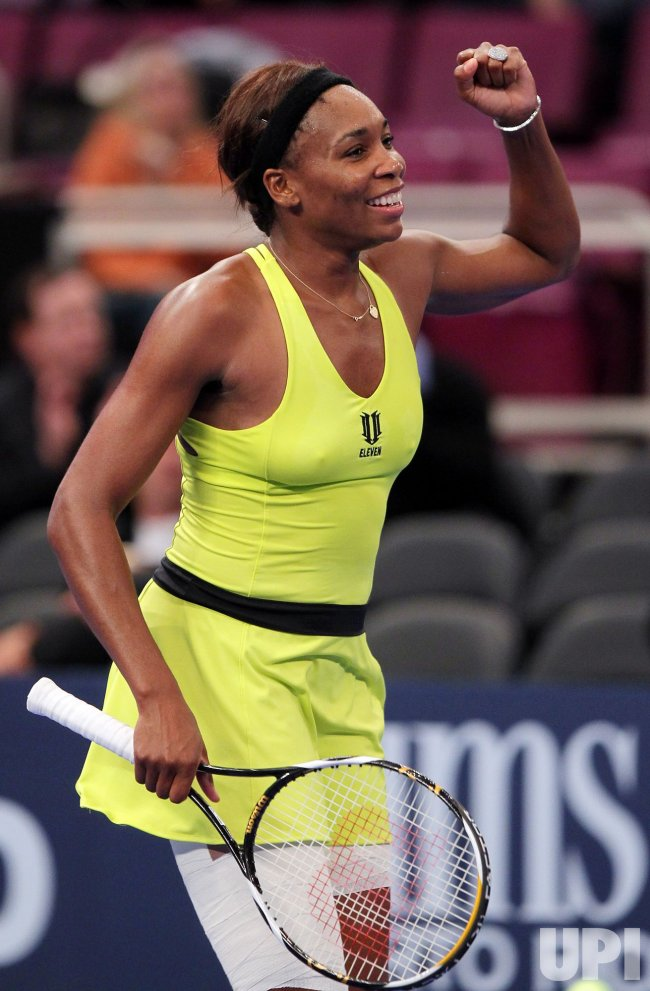 Venus Williams reacts after defeating Kim Clijsters at Madison Square Garden in New York