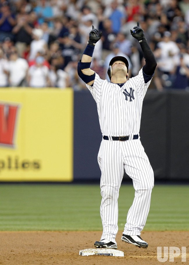 New York Yankees Nick Swisher reacts on second base at Yankee Stadium in New York