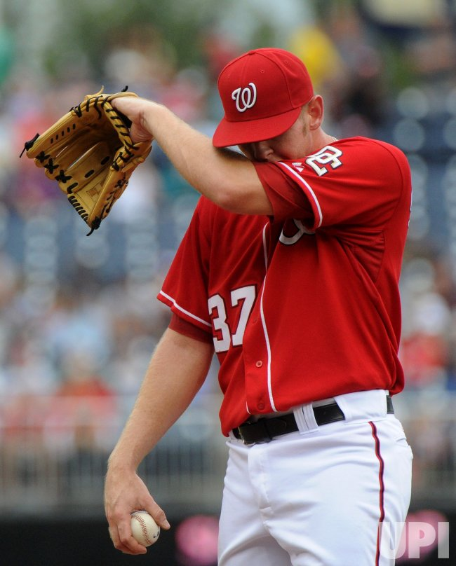 Nationals' pitcher Stephen Strasburg talks to Ivan Rodriguez in Washington