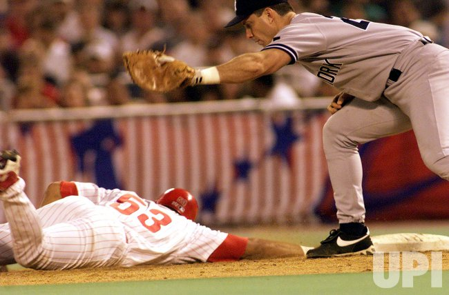 Phillies' Bobby Abreu (#53) dives back safely to first base